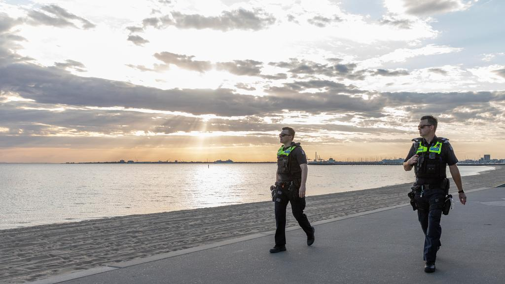 Police officers on patrol along the St Kilda foreshore yesterday. Picture: Asanka Ratnayake/Getty Images
