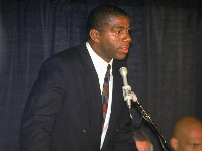 Magic Johnson at the press conference that stunned the world.