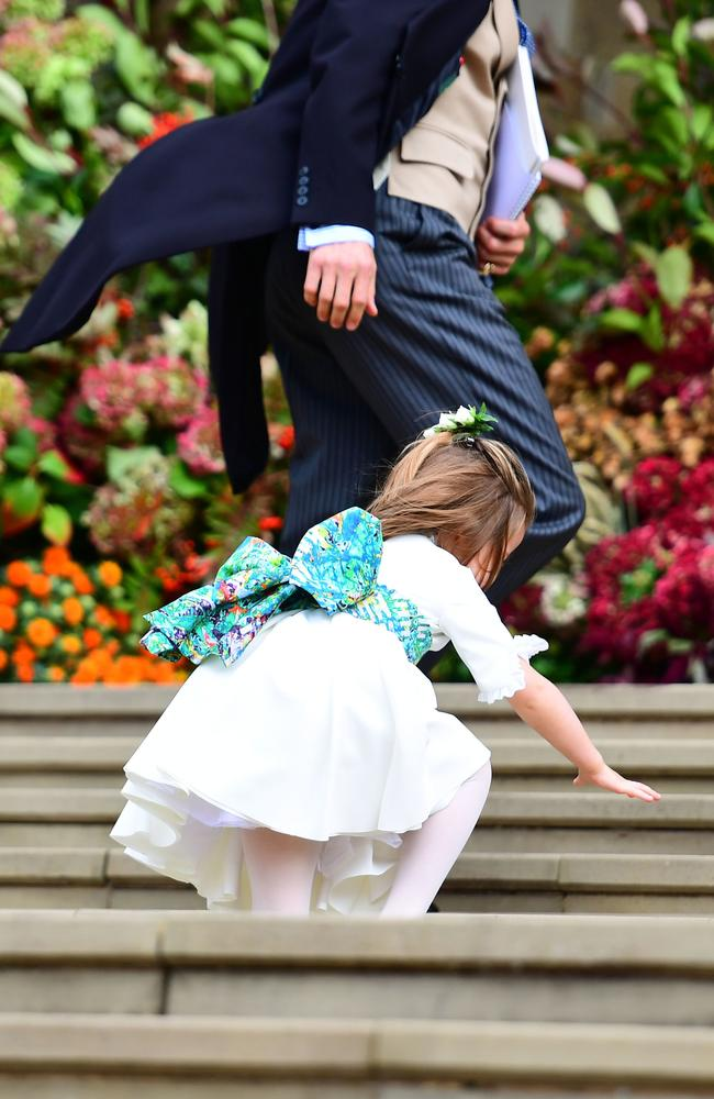 Princess Charlotte falls on the steps, as the bridesmaids and pageboys arrive for the wedding of Princess Eugenie. Picture: Getty