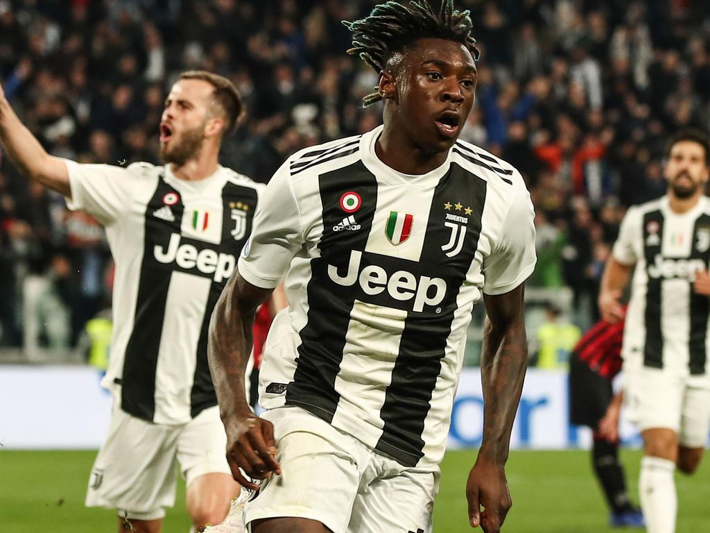 Juventus' Italian forward Moise Kean (C) celebrates after scoring during the Italian Serie A football match Juventus vs AC Milan on April 6, 2019 at the Juventus stadium in Turin. (Photo by Isabella BONOTTO / AFP)
