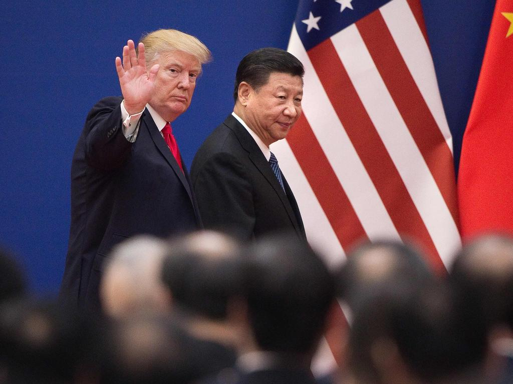 "TOPSHOT - US President Donald Trump (L) and China's President Xi Jinping leave a business leaders event at the Great Hall of the People in Beijing on November 9, 2017. Donald Trump urged Chinese leader Xi Jinping to work ""hard"" and act fast to help resolve the North Korean nuclear crisis, during their meeting in Beijing on November 9, warning that ""time is quickly running out"". / AFP PHOTO / Nicolas ASFOURI"