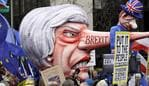 A doll resembling British Prime Minister Theresa May stands among demonstrators during a Peoples Vote anti-Brexit march in London, Saturday, March 23, 2019. The march, organized by the People's Vote campaign is calling for a final vote on any proposed Brexit deal. This week the EU has granted Britain's Prime Minister Theresa May a delay to the Brexit process. (AP Photo/Kirsty Wigglesworth)