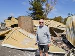 Trevor Kerber and his destroyed home Woodside in the Adelaide Hills. His home is at the former CFS water bomber airstrip. Picture: AAP/ Brenton Edwards