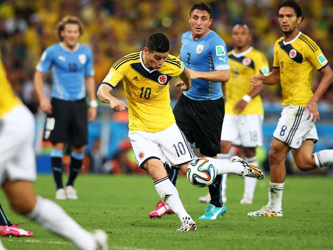 James Rodriguez prepares to fire home the goal of the World Cup.