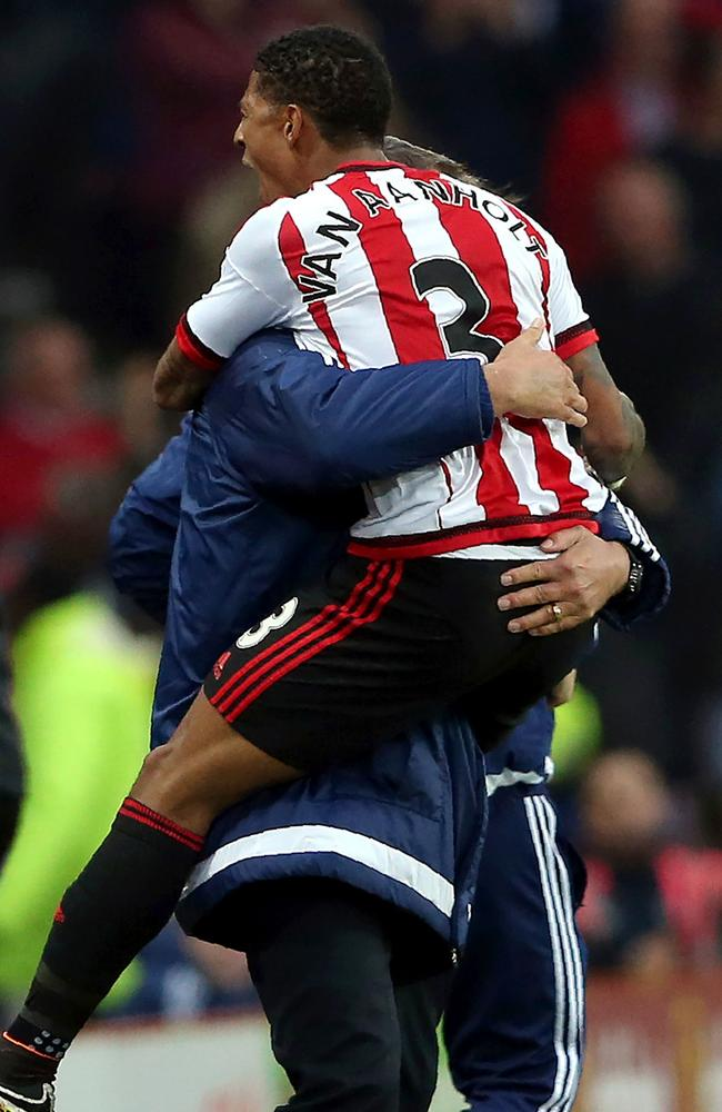 Sunderland's Dutch defender Patrick van Aanholt (R) with Sam Allardyce.