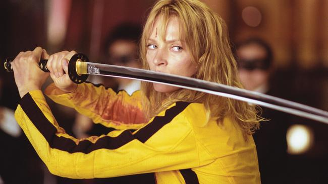 Only Uma Thurman could make a yellow and brown tracksuit look good.