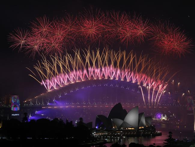 New Year's Eve 2018 - The midnight fireworks display over the Sydney Opera House and Sydney Harbour Bridge from a rooftop in Potts Point. Picture: Toby Zerna
