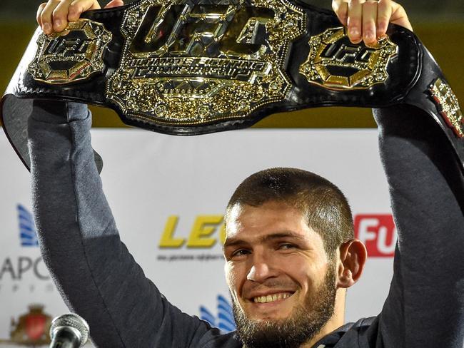 Khabib Nurmagomedov with his UFC lightweight title belt after beating McGregor.