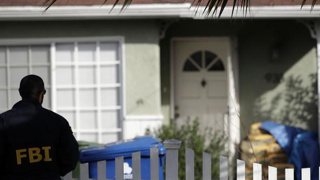 An FBI agent stands outside the home being searched for clues the Kristin Smart case. Picture: Marcio Jose Sanchez