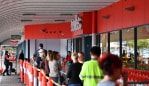 Shoppers are seen waiting outside a Coles supermarket at Firle in Adelaide, Monday, April 6, 2020. The Australian Government has announced even tighter restrictions around social gatherings, and boosted stimulus spending, in attempts to fight off the coronavirus and it's affects on the economy. (AAP Image/David Mariuz) NO ARCHIVING