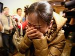 A relative of a passenger onboard Malaysia Airlines flight MH370 cries out at a local hotel where families are gathered on March 9, 2014 in Beijing, China. Malaysia Airline Flight MH370 from Kuala Lumpur to Beijing and carrying 239 onboard was reported missing after the crew failed to check in as scheduled while flying over the sea between Malaysia and Ho Chi Minh City in Vietnam. Picture: Feng Li/Getty Images