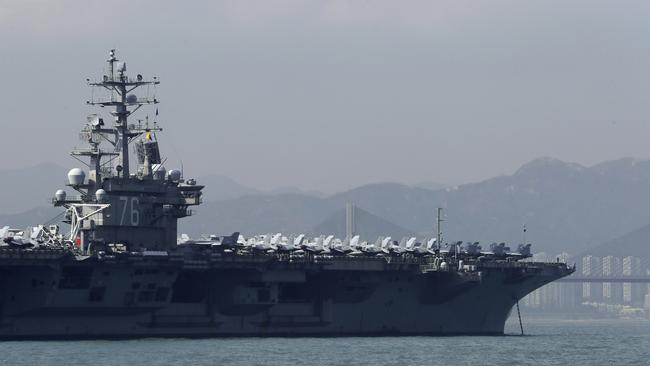 The US Navy's USS Ronald Reagan aircraft carrier anchored in Hong Kong ahead of a planned meeting between US President Donald Trump and Chinese leader Xi Jinping. Picture: Kin Cheung/AP