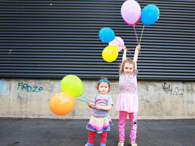 Charlotte, 20 months, and Amelia Reed, 5, pose at Hear & Say in Ashgrove, Brisbane on Wednesday, October 3, 2018. Loud Shirt Day is Friday, October 19. Picture: AAP/Claudia Baxter