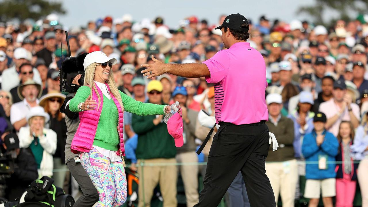 Patrick Reed celebrates with wife Justine after last year's Masters.