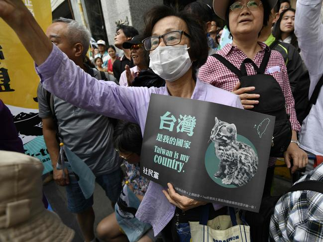 Pro-Taiwan independence activists call for the referendum on the streets in front of the headquarters of the ruling Democratic Progressive Party (DPP) during a demonstration in Taipei. Picture: AFP