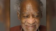 Fans are outraged at photo of Bill Cosby 'smiling' in a new mugshot