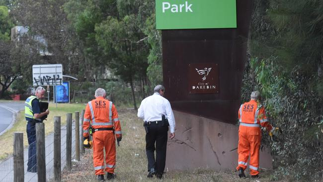 Police and SES crews do a line search in Bundoora Park. Picture: Tony Gough
