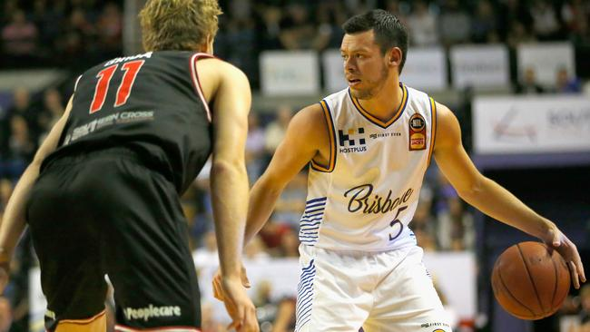 Jason Cadee of the Brisbane Bullets looks for a pass against the Illawarra Hawks on Saturday night. Picture: Getty Images