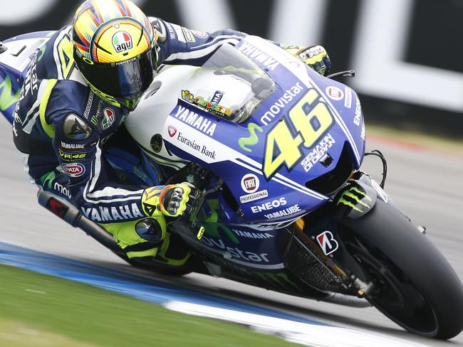 Valentino Rossi of Italy rides his Yamaha during qualifying for the Dutch MotoGP.