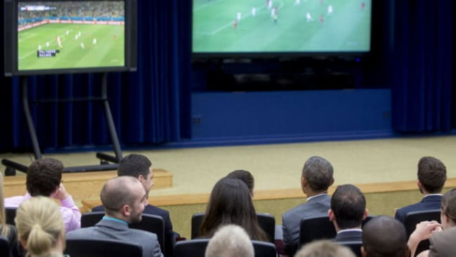 President Barack Obama (Front row, 2nd from right) watches the game at the Eisenhower Executive Office Building.