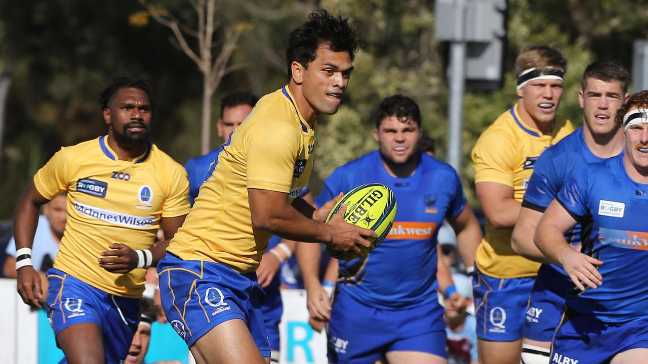 Karmichael Hunt carries the ball for Brisbane City.