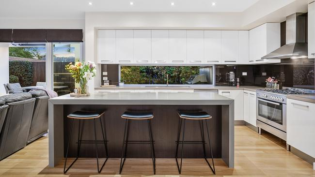 The kitchen is the heart of the open-plan living area.
