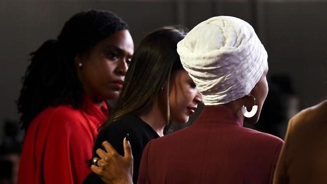 US Representatives Ayanna Pressley looks on as Ilhan Omar holds the shoulder of Alexandria Ocasio-Cortez. Picture: Brendan Smialowski / AFP