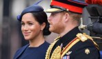 Britain's Meghan, Duchess of Sussex and Britain's Prince Harry, Duke of Sussex make their way in a horse drawn carriage to Horseguards parade. Picture: GettySource:AFP