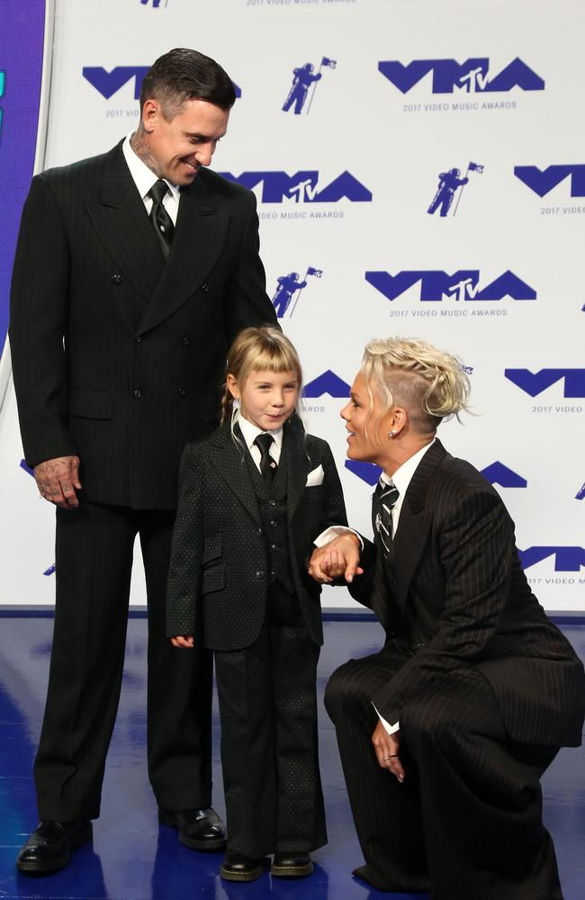 'We help other people to change so that they can see more kinds of beauty.' Pink, her husband Carey Hart and their daughter, Willow. Picture: AFP