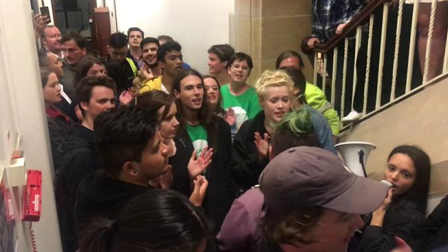 A video grab of protesters blocking the entrance to a talk by Bettina Arndt at Sydney University.