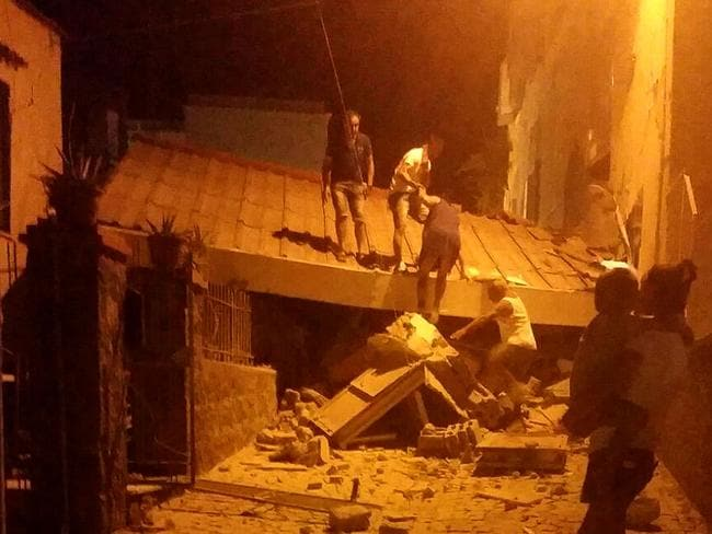 Earthquake victims are rescued in the popular Italian tourist island of Ischia. Picture: AFP