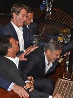 George Clooney seen tripping while exiting the taxi boat and entering a restaurant on September 26th 2014 in Venice, Italy. Picture: Splash