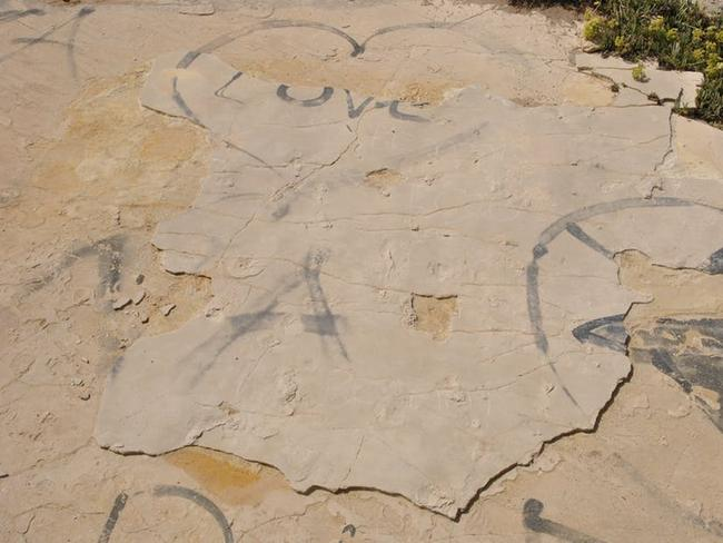 The vandalised site, showing fresh sand along the edges of the slab where it has been lifted and the holes left by the removal of two blocks in the centre. Picture: Babis Fassoulas / The Conversation