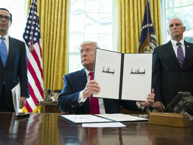 President Donald Trump holding his signed executive order to increase sanctions on Iran. Picture: Alex Brandon/AFP