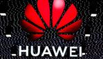 The Huawei logo is displayed at the Mobile World Congress (MWC) in Barcelona on February 26, 2019. - Phone makers will focus on foldable screens and the introduction of blazing fast 5G wireless networks at the world's biggest mobile fair as they try to reverse a decline in sales of smartphones. (Photo by Pau Barrena / AFP)