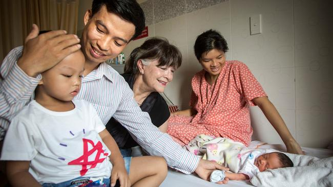 Gabi Hollow visits with Tran Van Giap's wife Le Thi Binh and son Tran Binh Minh, at Ho Chi Minh Hospital to welcome the arrival their new daughter Tran Thien Phuc. Picture: Michael Amendolia