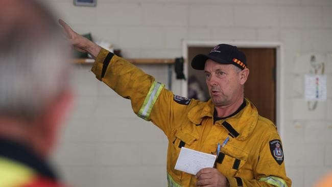 Tasmania Fire Service's Bill Coad gives a briefing to Tasmania Fire Service personnel at Geeveston fire station this morning. Picture: LUKE BOWDEN