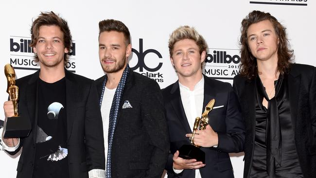 Louis Tomlinson, Liam Payne, Niall Horan, and Harry Styles of One Direction.