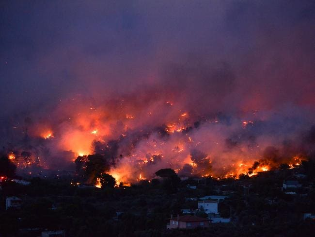 Flames rise as a wildfire burns in the town of Rafina, near Athens. Picture: AFP