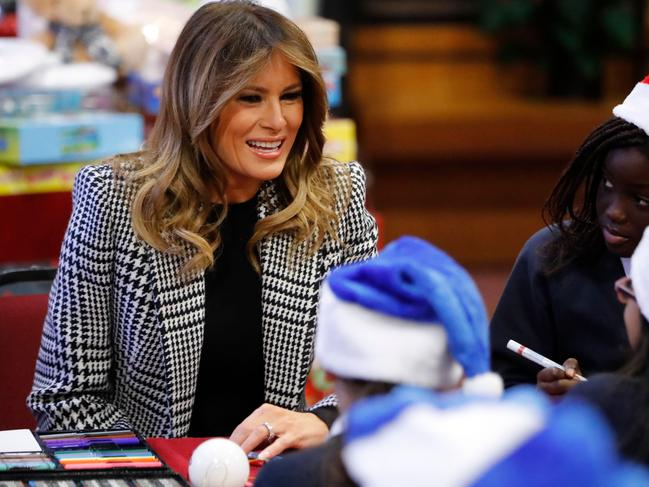 US First Lady Melania Trump was sung to by the children. Picture: Tolga AKMEN / AFP.