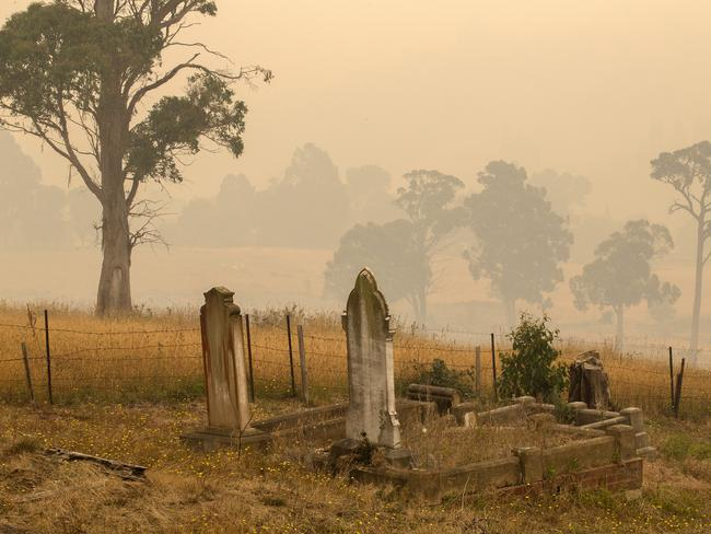 Smoke settles at Geeveston after the wind speed dropped. Picture: Chris Kidd