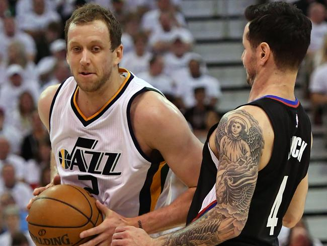 Joe Ingles #2 of the Utah Jazz elbows his way past JJ Redick #4 of the Los Angeles Clippers.