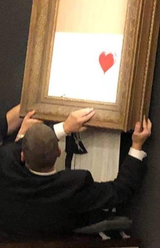 A photo of the destroyed Banksy art being taken down. Picture: Instagram/ Casterline Goodman Gallery.