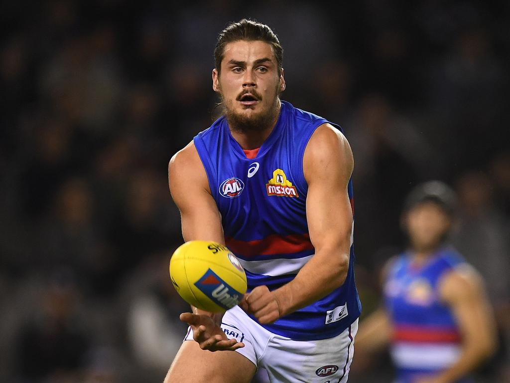 Tom Boyd of the Bulldogs is seen in action during the Round 10 AFL match between the Collingwood Magpies and the Western Bulldogs at Etihad Stadium in Melbourne, Friday, May 25, 2018. (AAP Image/Julian Smith) NO ARCHIVING, EDITORIAL USE ONLY