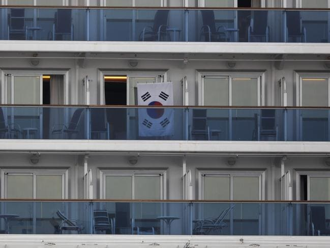 A South Korean flag hangs outside a cabin of the quarantined Diamond Princess cruise. Picture: Jae C. Hong