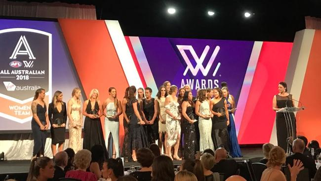 The 2018 AFLW All-Austtralian team on stage.