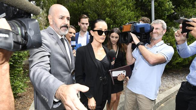Married At First Sight star Ines Basic is escorted to a limousine following her sentencing for drink-driving at the Cleveland magistrates court in Brisbane.