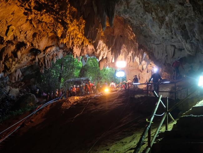 Rescuers install a water pump inside Tham Luang Nang Non cave.