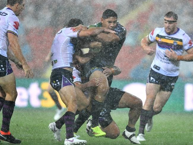 Jason Taumalolo (centre) of the Cowboys in action.