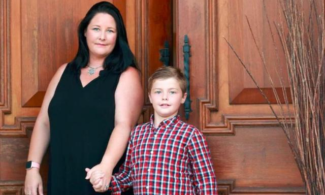 Katie Meredith and her son John, 9, - he ended up overnighting at Melbourne Airport in a storage room when diverted there on a Brisbane-Sydney Virgin flight. (AAP/Image Sarah Marshall)